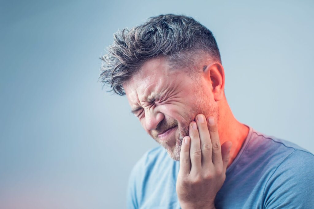 Man_in_Pain_Holding_His_Jaw_West_Hartford_CT_Dentist-1366x911-1-1024x683 What We Do